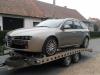 Odvoz nepojízdného vozidla Alfa do servisu.